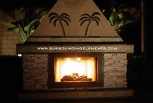 Mosaic Outdoor Fireplaces / Custom Design Mosaic Outdoor Fireplaces. Add an Outdoor Fireplace to your backyard to warm your guests on those chilly nights. Our Fireplaces can be designed to compliment your new or existing table set and barbecue island or even combined with an island. Every Fireplace is designed to operate on natural gas or propane. Wood logs can also be burned in these elegant fireplaces. Real-Fyre Gas Log Sets now available.
