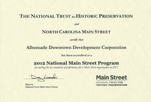 Behind the Scenes / ADDC was established in August of 1989 and has accomplished many tasks over the years. Our purpose is to aid and promote the redevelopment, improvement, beautification, and revitalization of downtown Albemarle.