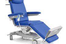 Idea treatment chair for hospital / 'Idea' treatment chairs range with height adjustable electric with 4000N telescopic column. Lying surface in three independently adjustable sections. Variable density paddings, upholstered with waterproof, fire-resistant imitation leather, resistant to disinfectants, with antimicrobial treatment.