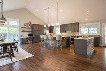 Easter Circle / Kitchen Redesigning with Columbia Cabinetry, Maple Cobblestone stain, Transitional flat panel door, White #Quartz countertops, Two islands, #Barnwood accents