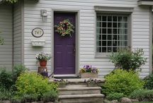 Outside Decor + Wreaths +Gardens / Backyard, garden, front yard, front door, door wreaths, wreath, planter, diy, fire pit, shutters, house number, welcome, sign, porch, stenciled, pallet furniture, vertical garden, cinder block bench, sectional, curb appeal, potting bench, flowers, front door, purple, yellow, red, black, paint concrete, water feature, door mat, welcome mat, walkway, marquee light, pallet herb garden, porch swing, window boxes,