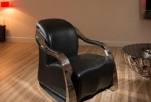 Modern Black Leather Stainless Steel Armchair / Black Leather Armchair. Features unique design, soft black leather upholstery and stainless steel frame. High quality Italian Leather. Also available in white leather.