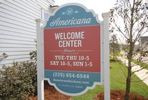 Americana Zachary Louisiana / Most exciting development in Zachary Housing Market since Copper Mill! Located in Zachary with THE BEST public school district in Lousiana 10 years running and a reasonable drive to work in Baton Rouge. It's one of the best kept secrets in Greater Baton Rouge Real Estate.  http://www.americanazachary.com/  Dog park, amphitheater on lake, YMCA tennis courts, pool, gym, Town Hall /Farmers Market, Walkons Restaurant and acres of green areas. Sammy's Grill within 1/2 mile. 2 golf courses nearby.   / by Bill Cobb