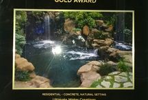 UWC Awards / Awards recognizing Don Goldstone & Ultimate Water Creations as Gold, Silver & Bronze winner.