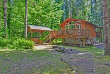 Riverwood Hideaway / Riverwood Hideaway is a cozy, romantic vacation rental cabin nestled among tall trees on the Sandy River at Mt Hood. Located at the end of a long road, you will enjoy seclusion, peace and quiet for your special getaway. Sip your morning coffee on the private forest view balcony in the bedroom at Riverwood Hideaway. Or enjoy the birdsong in the tall trees from the queen bed. 855-292-1776 http://www.mthoodrentals.com/vacation-rentals/brightwood/riverwood-hideaway/34