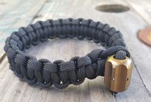 paracord bracelets / My paracord bracelets are tied with one of my titanium Hex XL lanyard beads. They contain at least six feet of black paracord that can be untied in an emergency. The inner strands can also be removed to make additional lines that can be used for fishing or making traps.