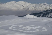 "Snow Art / These incredibly awesome snow designs are the work of artist Simon Beck, who takes the concept of a crop circle to new heights by strapping on a pair snowshoes and getting to work. ""The main reason for making them was because I can no longer run properly due to problems with my feet, so plodding about on level snow is the least painful way of getting exercise,"" he says."