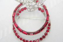Designer Jewelry / https://www.etsy.com/listing/548386604/red-trifari-brooch-designer-albert?ref=shop_home_feat_4