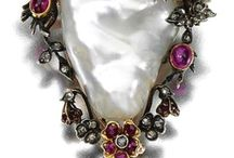 Exclusively blinged / Extremely exclusive, luxury, rich jewelry made of precious materials (metals and stones)