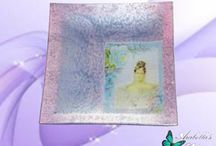 Plate tray of glass decorated in retro style with brilliant rough clay of color pink and lilac