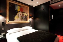 La Colère Room - 213 rue Croix Nivert, Paris 01 55 76 55 55 / Wrath : What better than red and black to evoke anger in those rooms ? Lightning on the cabinets, revolvers and pistols on the carpet or furniture handles, tagged tables... floor to ceiling, passion reveals the darkest side in each one of us.