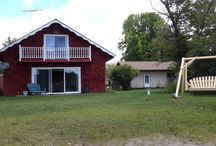 Vacation Rental~Irish Hills Lake House / Located directly on Mercury Lake, Irish Hills Lake House is a great lakefront property to enjoy with the family. With tire-swing, fishing boat, paddle boat and firepit, your family is sure to enjoy this relaxing and peaceful cottage.