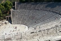 Where it all started for us / Ancient Theatre of Epidaurus   30 Km away from Tolo, Argolida, the huge theatre of Epidavros delightes for its symmetry and beauty. Designed in the 4th century BC, it's marveled for its exceptional acoustics, which permit perfect intelligibility of unamplified spoken word from the centre-stage to all 15,000 spectators, regardless of their seating. Famously, tour guides have their groups scattered in the stands and show them how they can easily hear the sound of a match struck at stage.