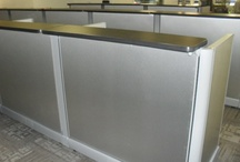 Stainless steel Herman Miller cube install / These are cubicles that Modern Modular refurbished for Mountain West Telecom in Salt Lake City, Utah. They are done with stainless steel laminate panels and black laminate surfaces. We can create this same look for your company and deliver and install all over the world.