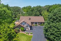 SOLD - 21700 Hidden Valley Drive - Kildeer, IL 60047 / $473,900 - Breathtaking water & nature views from every room in this fabulous Colorado inspired Tudor style waterfront home on 1.2 acres in the heart of Kildeer. This gem has a spacious floor plan with a huge loft, 1st floor & 2nd f floor master bedroom suites & a flexible floor plan for all lifestyles.  Full finished lower level, wet bar, full bedroom, bathroom & storage/pantry room with custom shelving. Fish, boat, ice skate or relax on your deck while overlooking the water.