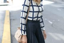 checked top with black skirt