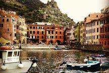"""Where to stay and things to see in Cinque Terre / Cinque Terre means """"Five lands"""", is a combination of five beautiful small villages of Italy on the coastline of Italian Riviera surrounded by the beautiful hillsides. Five villages which comprises Cinque Terre are Monterosso al Mare, Vernazza, Corniglia, Manarola, and Riomaggiore. They are listed on the UNESCO World Heritage List."""