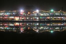 Nice places to hangout with friends and family / Metrol Walk and Adventure Island in New Delhi, India  The beauty of Metro Walk Mall and Adventure Island gets amazing in nighttime. The shining lights and its shadow in the lake dividing these cool places is awesome and heart touching. I would rate this hangout place in Delhi as 8/10 for people who want to engage in adventures in the morning and enjoy the calmness and brightness of nightlife in Delhi.