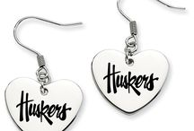 Nebraska Cornhuskers Jewelry / Chartered in 1869, The University of Nebraska has almost one hundred and fifty years of being an outstanding university. Celebrate and represent Cornhusker pride with a wide selection of high quality Nebraska Cornhuskers jewelry. ---------------------------------------------------------------------------- New jewelry and Nebraska Cornhuskers products will periodically be added to this board!