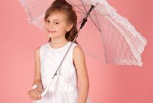 Communion Parasols / Communion Parasols& Communion Umbrellas for girls. We have First Communion umbrellas and parasols in a range of materials including beautiful lace parasols to add an elegant vintage touch to your little girls Communion dress style. Dainty Communion gloves match beautifully with a parasol.– a delightful accessory for your little girls First Holy Communion day.