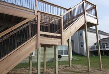 Oconomowoc New Deck Construction / Advantage Carpentry & Remodeling sat down with the client of this new home and together designed a deck that includes all solid cedar wood decking and rails and black aluminum balusters that give the deck a modern feel. Also taken into consideration were the children and pets with the locking gate at the top of the stair.