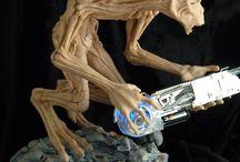 Alien armed with a anti-gravity-gun.