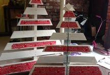 Projects to Try / No mess Xmas Tree. I used 1 pallets to create 2 Xmas Trees. All you need to do is saw your shape to make 1 tree and use the sawn off pieces to make another. Paint and decorate. I used white paint and rubbed it with a wet rag to give a washed effect then tore strips to Xmas paper and glued them on. I then made a star from the cut off pieces.