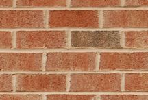 Old South   Triangle Brick Company / Understated dark flashing, cream accents and hues ranging from rosy pink to rich orange add subtle depth to Triangle Brick Company's bright, beech-colored Old South brick, giving it a look that's reminiscent of a drive down the Blue Ridge Parkway. Offered under our Standard product tier, this sand-faced brick can be incorporated into residential or commercial projects of all types for a building that elegantly complements its surroundings.