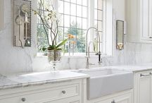 Marble countertops for bathrooms / White kitchens