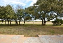 New Listing in Leander, TX Offered at $405,000 / Huge country home on 4 acres! Home features front gate access, French doors, lots of windows providing the home with natural light, fireplace, built in bookshelf, and more! Kitchen/dining combo boasts lots of storage and counter space. Master features full bath with double vanity, and large closet. Exterior features extended patio, storage unit, and beautiful country views. perfect home for quiet country living!