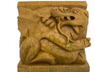 Timber-Treasures Welsh dragon carving / Our Welsh dragon carvings are copies of one carved into the back of a stone bench in a chapel at St David's Cathedral in west Wales, dating from around 1340. The red Welsh dragon owes its origins to folklore and Arthurian legend, originating from a serpent representing the Welsh god Dewi. The red dragon has since gone on to symbolise an independent and defiant Wales. Dimensions: 10 x 10 x 5 cms* *handmade disclaimer