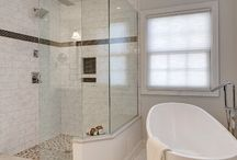 Grandview Heights Open and Refreshing Spa Space / This was a full bath remodel from a home built in the early 1900's. It features a spa quality shower with spacious seating, double rain shower heads, his and her vanity, alcove storage, and a stand alone tub to give it a modern Victorian feel.
