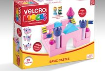 VELCRO® Blocks™ Construction Sets / Brand new and innovatively designed, the VELCRO® Blocks™ construction sets come with EVA foam VELCRO® Blocks, ABS plastic parts and accessories and connect with patented VELCRO® Brand Dots. These fun and safe toys are geared for children 3 and above.