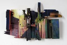 "Thomas Wilcox / Thomas paints atmospheric streetscape scenes on found wooden planks and panels, assembled in rustic, artful constructions. The complex pieces are carefully hammered together to make a foundation for the artwork,  giving each painting depth, rawness and texture. ""Using waste to make art is an amazing transformation for me. Recycling materials creates a need for a different way of thinking about a painting,"" says Thomas."