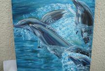játszó delfinek