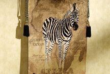 Wild about Zebras / Surprisingly versatile, zebra prints are a fashionable, fun addition to many decorating styles. Use them in a more traditional room for a pop of flair, or play them up for a bold safari statement. / by Touch of Class