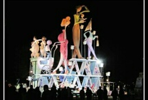 "Fallas in Valencia (Spain) / The focus of the fiesta is the creation and destruction of ninots (""puppets"" or ""dolls""), which are huge cardboard, wood, paper-machè and plaster statues."