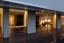 House Built Into the City. Architecture by Fran Silvestre Arquitectos. / House built into the city. Valencia (Spain).  This refurbished penthouse is located in a 1970s 16-storey building in Blasco Ibáñez Avenue, Valencia.  The project takes the original highly fragmented layout and connects and widens the rooms by modifying the interior architecture through floor-to-ceiling hinged doors and sliding doors hidden in panelled walls.