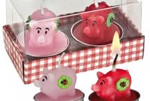 Very interesting candle.  I wonder how long it will take for the pig to melt away.