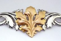 Pins - Symmetry Jewelers / Intricate, beautiful pin designs designed by Tom Mathis of Symmetry Jewelers in New Orleans.  Items may not all be immediately available, but can be custom-ordered. Please call or come in for more details.