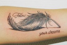 "feathers tattoo ""querer es poder"""