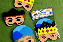 "Purim / The holiday of Purim is the paradigm of Jewish deliverance from cruel tyranny. The traditional food eaten on Purim is a hamentaschen, triangular filled cookies representing the hat Haman wore. On Purim it is tradition to send shalach manot-gift baskets, and to give to charity. YUSSEL'S PLACE has a full assortment of ""shlock"" boxes, candy, chocolate, groggers, masks, Purim stickers, Purim bags and goodies to fill your baskets."