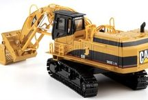 Earth Moving Models - 1:50 Scale / 1:50 and 1:87 Scale Mining Dump Trucks, Dozers, Front Shovels, Excavators, Wheel Loaders, Track Loaders, Motor Graders, Scrapers, Backhoes, Pipelayers, Log Loaders and Wheels Skidders By World Leading Manufactures such as Diecast Masters, Ertl, Norscot, NZG, First Gear, Universal Hobbies, MotorArt and Conrad. Brands include Caterpillar, Komatsu, Hitachi, John Deere, Liebherr, Volvo, International Harvester, Case, Bobcat, New Holland and Allis Chalmers.