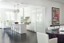 glossy white kitchen in traditional frames