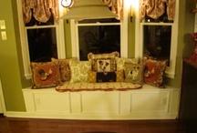 DIY window seats with stirage / by Kim Monasterial