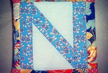 Lu Flux patchwork alphabet cushions