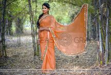Tangerine Garden Silk Chiffon Ribbonwork Saree / PRICE: INR 9,632.00; US$ 145.94 To buy click here: https://goo.gl/uIfTuq Featuring the Tangerine Garden saree in 100% flat, pure silk chiffon in warm orange and floral ribbonwork embroidery that is sublimely romantic and exudes sophisticated elegance. The edges are decorated with enamoring thin, delicate, white lace. The blouse back has a white lace false closure and white buttons for the perfectly feminine finish. Reach us at care@eastandgrace.com. With Love, EAST & GRACE www.eastandgrace.com