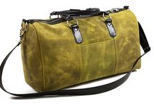 3.7.6. Weekender Bag VRG91 (314649) / Techno-yellow and black natural leather, black fabric inside weekender bag.