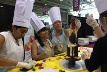 "Chocolate Team Building Events / Our Chocolate Sculpture Challenge will determine which team can effectively communicate under pressure to build the tallest freestanding sculpture made entirely of chocolate for their ""VIP client"""