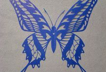 butterflies in paper cutting with scissors